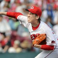 Hiroshima Carp pitcher Kenta Maeda was on Monday named this year's Sawamura Award winner, after going 15-8 with a 2.09 ERA and 175 strikeouts in 206⅓ innings this season. | KYODO
