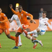 Vladimir Darida of the Czech Republic (right) tries to control the ball ahead of the Netherlands' Georginio Wijnaldum during their Euro 2016 qualifier in Amsterdam on Tuesday.   REUTERS