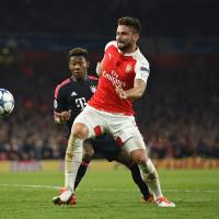 Arsenal's Olivier Giroud competes against Bayern Munich's David Alba during their Champions League match on Tuesday in London. | REUTERS