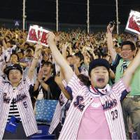 Swallows fans are ecstatic on Friday as Tokyo Yakult collects its first Central League pennant since 2001. KYODO | KYODO