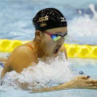 Kanako Watanabe competes in the women's 200-meter breaststroke race on Thursday at Tokyo Tatsumi International Swimming Center. Watanabe placed second with a time of 2 minutes, 23.43 seconds. | KYODO