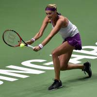 Muguruza, Radwanska reach last four at WTA Finals