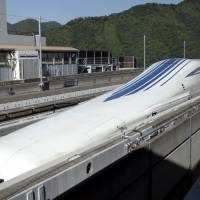 An L0 series magnetic levitation (maglev) train, developed by Central Japan Railway Co. (JR Central), sits on a track ahead of a trial run at the Yamanashi Maglev Test Track site in Tsuru, Yamanashi Prefecture, on June 4. | BLOOMBERG