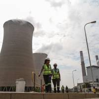 Cooling towers at the Grootvlei power station, operated by state-owned utility Eskom, in Grootvlei, South Africa | BLOOMBERG