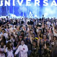 People dressed up like zombies take part in a Halloween event Saturday at Universal Studios Japan in the city of Osaka.   KYODO