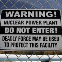A warning sign hangs on a fence outside the Diablo Canyon nuclear power plant in Avila Beach, California, in March 2012. | BLOOMBERG
