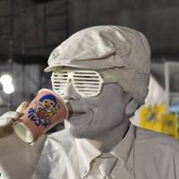 Acting up: A mime takes a drink — or pretends to — at the Moshi Moshi Nippon Festival on Sunday. | MIINA YAMADA