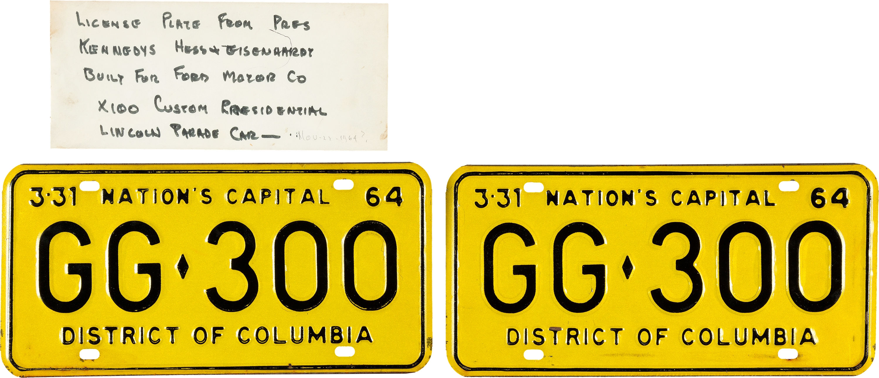 The license plates that were on the limousine carrying President John F. Kennedy when he was assassinated in Dallas on Nov. 22, 1963, are seen in this undated photo. The plates, which were discarded when the vehicle was sent for upgrades, are going up for auction. | AP