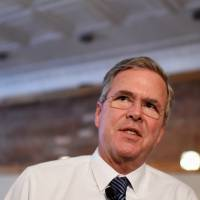 Bush differs with GOP cohorts on Syria refugee entry, qualifies Christian-only comment