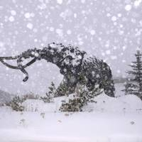 The statue of a Wooly Mammoth can be seen as snow falls on Mammoth Mountain in California Monday.   REUTERS/KEVIN WESTENBARGER / MAMMOTH MOUNTAIN SKI AREA / HANDOUT VIA REUTERS