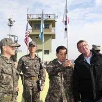 Carter at DMZ calls on Pyongyang to end nuclear arms quest, admits prospects dim