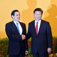 Xi and Ma hold first talks between leaders of China and Taiwan since civil war ended