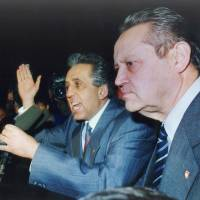 This Nov. 8, 1989, file photo shows Politburo member Guenther Schabowski (right) and Egon Krenz, chairman of East Germany's privy council, talking to demonstrators in East Berlin. Schabowski, whose cryptic announcement that the communist country was opening its fortified border, precipitated the fall of the Berlin Wall. He died in a Berlin nursing home on Sunday. | AP