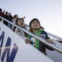 Refugee-flooded Greece puts first 30 aboard Luxembourg-bound plane under relocation plan