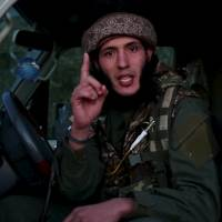 A man identified in the subtitiles as Al Ghareeb the Algerian speaks at an undisclosed location in this image taken from undated video footage released by the Islamic State, which warned in the new video Monday that countries taking part in airstrikes against Syria would suffer the same fate as France, and threatened to attack in Washington. The video, which appeared on a site used by Islamic State to post its messages, begins with news footage of the aftermath of Friday's Paris shootings in which at least 129 people were killed. | REUTERS / SOCIAL MEDIA WEBSITE VIA REUTERS