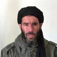 A file undated grab from a video obtained by ANI Mauritanian news agency reportedly shows former Al-Qaeda in the Islamic Maghreb (AQIM) emir Mokhtar Belmokhtar speaking at an undisclosed location. France's defense minister said on Friday that notorious Algerian militant Mokhtar Belmokhtar was 'likely behind' a deadly attack at a luxury hotel in Mali but acknowledged it was not certain. | AFP-JIJI