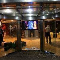 U.N. officials exit the Radisson hotel in Bamako, Mali, on Friday. Around 19 people were reported dead on Friday after Malian commandos stormed a hotel seized by Islamist gunmen to rescue 170 people. | REUTERS