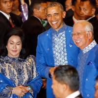 In Asia, Obama takes softer tone on human rights, corruption