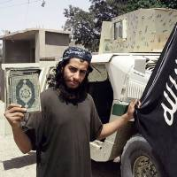 Belgian militant Abdelhamid Abaaoud, the suspected mastermind of a the Paris terrorist attacks, is seen in a picture from a February 2015 edition of the Islamic State group's online English-language magazine. | AFP-JIJI