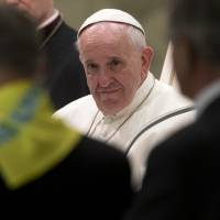 Pope Francis listens to a speech during an audience with members of the Don Guanella charity organization, in the Pope Paul VI hall, at the Vatican, Thursday.   AP