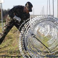 Slovenian army installing razor wire 'obstacles' on Croatia border to manage migrants