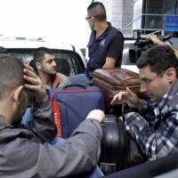 Syrians, with smugglers' help, fleeing war via Latin America, many on forged Greek passports