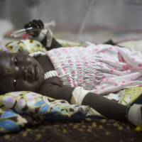 Man held, shielded baby survivor of South Sudan plane crash; toll at 37