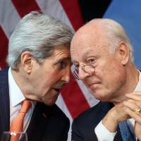 U.S. Secretary of State John Kerry speaks with U.N. Special Envoy for Syria Staffan de Mistura during a news conference in Vienna on Saturday. | AP