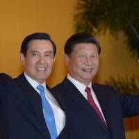With handshake, China's Xi seeks influence in Taiwan ahead of January vote
