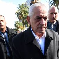 Nobel Peace Prize winner and Tunisian General Labour Union (UGTT) general secretary Houcine Abassi visits the site the day after a bomb attack on a bus that was transporting Tunisia's presidential guards in central Tunis on Wednesday. | AFP-JIJI