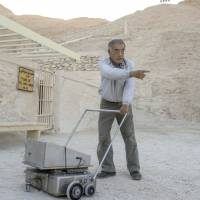 Japanese expert Hirokatsu Watanabe pulls his radar equipment outside King Tutankhamun's burial chamber in the Valley of Kings near Luxor in southern Egypt on Saturday. | AFP-JIJI