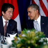 Prime Minister Shinzo Abe and U.S. President Barack Obama speak ahead of their bilateral meeting on the sidelines of the Asia-Pacific Economic Cooperation summit in Manila on Thursday. | REUTERS