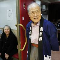 Hisayuki Matsukura, chairman of Toyo-kan, formerly the Asakusa France-za theater, stands at the entrance of the entertainment hall in September in Tokyo's Asakusa district. | KYODO