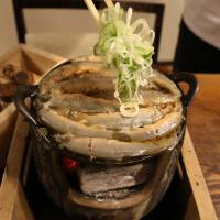Loach stew is served at Komakata Dozeu, a restaurant with two centuries of history, in Tokyo's Taito Ward. | RINI ISHII