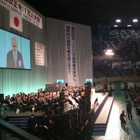 Nippon Budokan Hall in Chiyoda Ward, Tokyo, is packed Tuesday afternoon with people calling for revisions to the pacifist Constitution. | REIJI YOSHIDA