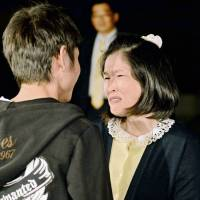 Keiko Aoki, who spent 20 years behind bars for arson and murder, meets her son Oct. 27 after she was released from prison the previous day. | KYODO