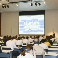 Employees attend a seminar on the upcoming debut of the annual 'stress check' offering in Tokyo in October.   KYODO