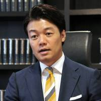 Taichiro Motoe, president and CEO of Bengo4.com, speaks during an interview in Tokyo on Oct. 2.   YOSHIAKI MIURA