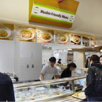 Students order food on Wednesday at Ritsumeikan Asia Pacific University's halal-certified cafeteria in Beppu, Oita Prefecture.