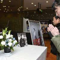 Fans of deceased actress Setsuko Hara pray Thursday at the Togeki movie theater in Tokyo, where her representative works are now showing in her memory. | KYODO