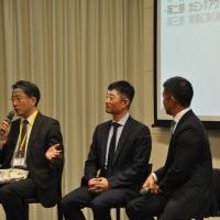 Hiroki Inaba (center), a vice president in the legal department of Goldman Sachs Japan Co., who is gay, prepares to share his experience of coming out at work at an event in Tokyo on Nov. 6. | KYODO