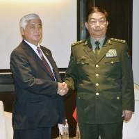 Defense Minister Gen Natakani greets Chinese counterpart Gen. Chang Wanquan (right) ahead of their meeting Wednesday on the sidelines of a regional security gathering in Kuala Lumpur. | KYDOO