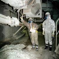 Workers inspect conditions at the Monju prototype fast-breeder reactor in Tsuruga, Fukui Prefecture, after a sodium leak in December 1995.   KYODO