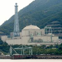 The troubled Monju fast-breeder reactor, which has cost the taxpayer more ¥1 trillion and remains idle, stands on the coast of Tsuruga, Fukui Prefecture. The Nuclear Regulation Authority on Friday advised the science minister to find a new operator. | KYODO