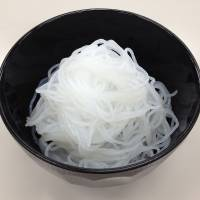 Omikenshi's noodles are made from a mixture of cellulose pulp and konnyaku (devil's tongue) roots. | OMIKENSHI CO.