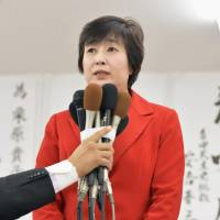 Takako Kurihara, a former Osaka Prefectural Assembly member supported by the ruling Liberal Democratic Party, declares defeat on Sunday night. | KYODO