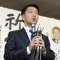 Akira Yanagimoto, a former Osaka Municipal Assembly member backed by the Liberal Democratic Party in Sunday's mayoral election, declares defeat Sunday night. | KYODO