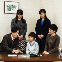 Prince Akishino (left) speaks with his wife Princess Kiko (right) and their children, Princess Mako (standing, left), Princess Kako (standing, right) and Prince Hisahito (center) at their residence in Tokyo on Nov. 15. | AFP-JIJI