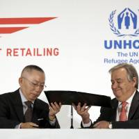 UNHCR chief urges Japan to open up to refugees; Fast Retailing pledges clothes, training
