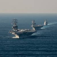 U.S. aircraft carrier USS Ronald Reagan steams ahead of Japan Maritime Self-Defense Force destroyers JS Izumo and JS Teruzuki in waters south of Japan during a fleet review on Oct. 18. | USS RONALD REAGAN (CVN 76)